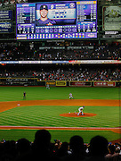 Apr 2, 2013; Houston, TX, USA; Texas Rangers starting pitcher Yu Darvish (11) lets a ball go between his legs to break 8 2/3 perfect innings against the Houston Astros in the ninth inning at Minute Maid Park. The Rangers won 7-0. Mandatory Credit: Thomas Campbell-USA TODAY Sports