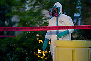 Hazmat crews clean up hazardous material outside the apartment where a second Ebola patient has been reported in Dallas, Texas on October 12, 2014. (Cooper Neill for The New York Times)