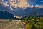 Storm light on the North Saskatchewan River. <br />David Thompson Highway<br />Alberta<br />Canada