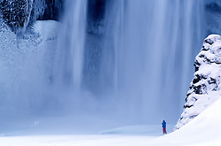 Tourists at the waterfall, Skogafoss, Iceland - Ferðamenn við Skógafoss
