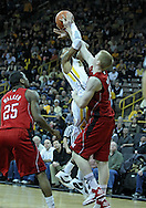 January 26, 2012: Iowa Hawkeyes guard/forward Roy Devyn Marble (4) is fouled by Nebraska Cornhuskers forward Brandon Ubel (13) during the NCAA basketball game between the Nebraska Cornhuskers and the Iowa Hawkeyes at Carver-Hawkeye Arena in Iowa City, Iowa on Thursday, January 26, 2012.