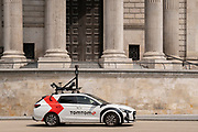 A car equipped with camera and mapping technology for the SatNav brand TomTom drives beneath the pillars and column architecture of Sir Christopher Wren's St Paul's Cathedral south transept, on 24th June 2021, in London, England. CREDIT RICHARD BAKER.