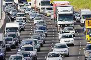 Traffic congestion cars and trucks on M25 motorway, London, United Kingdom