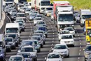 Traffic congestion cars and trucks on M25 motorway, London, United Kingdom