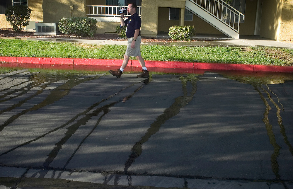 Las Vegas Valley Water District Conservation Aide Dennis Gegen videos water runoff from sprinklers at an apartment complex in Las Vegas.