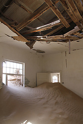 WINDHOEK, Nov. 25, 2013  Photo taken on Nov. 23, 2013 shows the interior of the abandoned hospital in ''Ghost Town'' Kolmanskop, Namibia. Kolmanskop is a ghost town in the Namib desert in southern Namibia. In 1908 a diamond was found in this area, which led to a huge and frantic diamond rush by German settlers. Driven by the enormous wealth of the first diamond miners, the residents built the village in the architectural style of a German town, with amenities and institutions including a hospital, ballroom, school, casino and even an x-ray-station. The town declined after World War I when the diamond field slowly exhausted and was ultimately abandoned in 1954. Now it is a popular tourist destination. (Xinhua/Gao Lei) (Credit Image: å© Gao Lei/Xinhua/ZUMAPRESS.com)