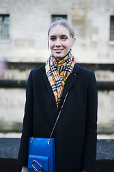March 4, 2018 - Paris, France - A model, wearing blue coat and Burberry scarf, is seen in the streets of Paris after the Valentino show during Paris Fashion Week Womenswear Fall/Winter 2018/2019 on March 4, 2018 in Paris, France. (Credit Image: © Nataliya Petrova/NurPhoto via ZUMA Press)