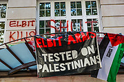 """A general view shows a banner that reads """"Elbit Arms Tested on Palestinians"""" hanged on the rooftop of the entry door outside Elbit Systems HQ office at 77 Kingsway, central London after Palestine Action activists scaled Elbit's entry building on Friday morning, Aug 6, 2021. (VX Photo/ Vudi Xhymshiti)"""