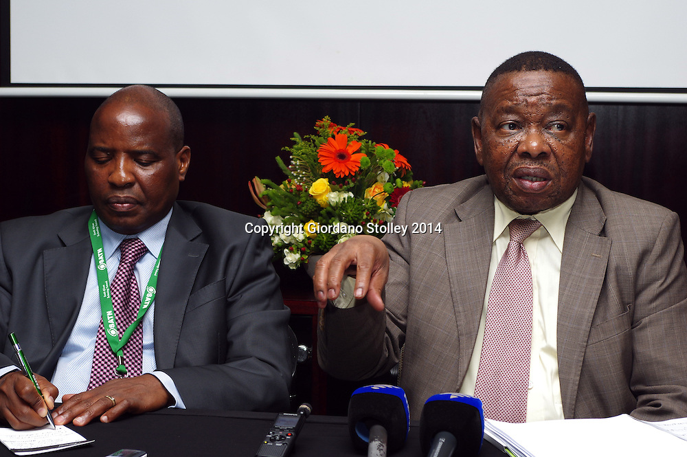 DURBAN - 14 October 2014 - South Africa's Higher education minister Blade Nzimande (right) speaks at a press conference  following the opening of the opening of the 7th South African Technical network conference --  an annual conference where leaders of the country's universities of technology gather to exchange ideas. Professor Mashupye Kgaphola, the vice chancellor of the Mangosuthu University of Technology  takes notes. Picture: Allied Picture Press/APP
