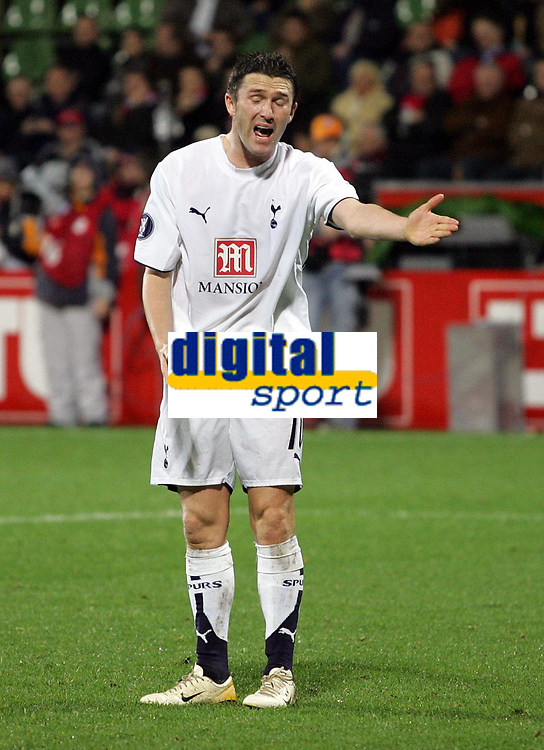 """Photo: Paul Thomas.<br /> Bayer Leverkusen v Tottenham Hotspur. UEFA Cup. 23/11/2006.<br /> <br /> Robbie Keane of Spurs complains and shows his frustration to Mido about his """"non pass"""" in front of goal."""
