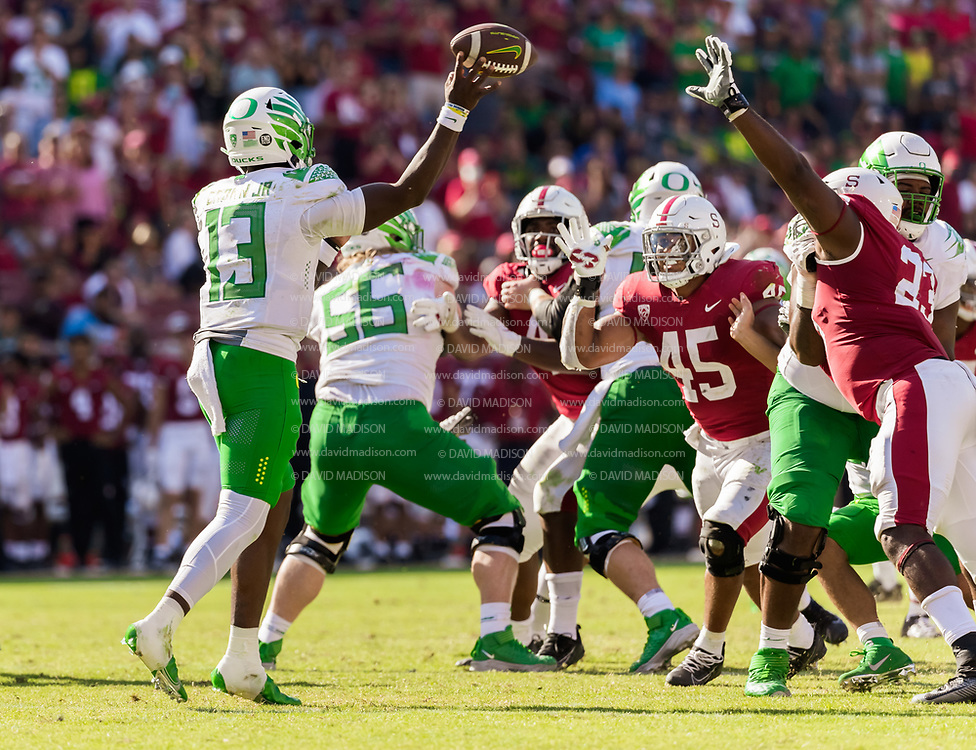 PALO ALTO, CA - OCTOBER 2:  Anthony Brown #13 of the Oregon Ducks throws a pass under pressure from Ricky Miezan #45 and Ryan Johnson #23 of the Stanford Cardinal during an NCAA Pac-12 college football game against the Oregon Ducks on October 2, 2021 at Stanford Stadium in Palo Alto, California.  (Photo by David Madison/Getty Images)
