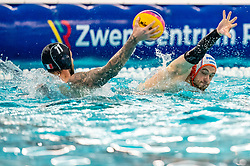 Pascal Janssen of the Netherlands in action against Pierre-Frederic Vanpeperstraete of France during the Olympic qualifying tournament. The Dutch water polo players are on the hunt for a starting ticket for the Olympic Games on February 17, 2021 in Rotterdam