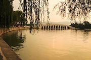 China, Beijing, Summer Palace built by Empress Cixi Seventeen Arched Bridge