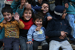January 1, 2018 - Gaza, Palestinian Territories, Palestine - Palestinian children Smile during playing outside their house during the cold and rainy weather in the Jabalia refugee camp in the northern Gaza Strip on January 1, 2018. (Credit Image: © Majdi Fathi/NurPhoto via ZUMA Press)