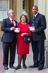 BTP Constable Wayne Marques, George Medal, poses withParents Mr. Joaquin Echeverria Alonso and Maria, Mrs. Miralles De Imperial Hornedo of London Bridge attack hero  Ignacio Echeverria received the medal awarded to their late son,  at an investiture by Her Majesty The Queen at Buckingham Palace in London. London, October 11 2018.