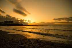 © Licensed to London News Pictures. 31/12/2016. Aberystwyth, Wales, UK. Sunset over the sea and pier in Aberystwyth on the last day of the year - - the weather in the west has been clear, in sharp contrast to the thick fog covering much of south east England. Photo credit: Keith Morris/LNP