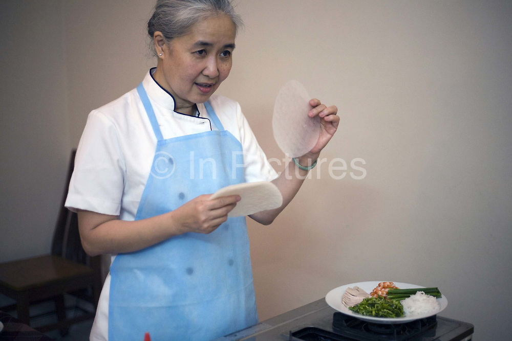 Cam Van, Vietnam's first television chef demonstrates how to make traditional Vietnamese dipping sauces at her restaurant, Doan Cam Van, Ho Chi Minh City (formerly Saigon), Vietnam
