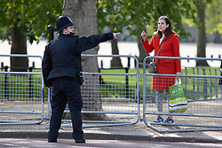 © Licensed to London News Pictures. 11/05/2021. London, UK. A police officer gives direction to a member of the public on the Mall ahead of the state opening of Parliament . Photo credit: George Cracknell Wright/LNP
