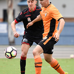 BRISBANE, AUSTRALIA - DECEMBER 10: Joshua Mori of Adelaide United is tackled by Nathan Konstandopoulos of the Roar during the round 5 Foxtel National Youth League match between the Brisbane Roar and Adelaide United at AJ Kelly Field on December 10, 2016 in Brisbane, Australia. (Photo by Patrick Kearney/Brisbane Roar)