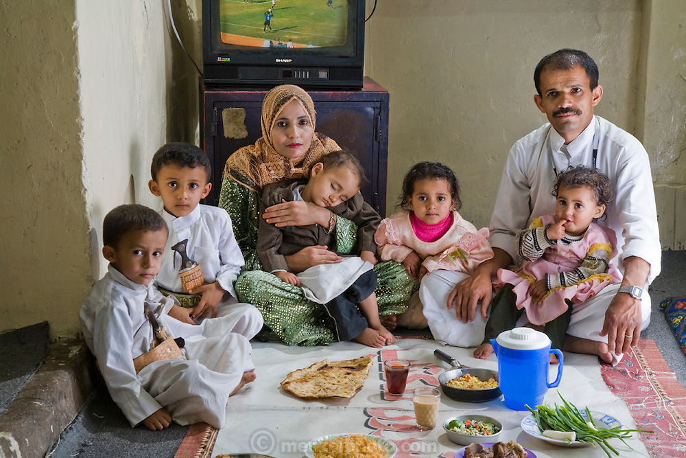 Saada Haidar, a housewife, with her husband, their three sons and visiting nieces at her home in Sanaa, Yemen. (Saada, 27, is featured in the book What I Eat: Around the World in 80 Diets.)