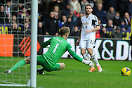 Angel Rangel of Swansea city watches as his effort goes past Man city keeper Joe Hart. Barclays Premier league, Swansea city v Manchester City at the Liberty Stadium in Swansea,  South Wales on  New years day Wed 1st Jan 2014 <br /> pic by Andrew Orchard, Andrew Orchard sports photography.