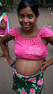 Over the last quarter-century, a few Embera families pushed further North of Darien, settling in the jungles bordering the Ipeti? River -- a scant two-hour journey from cosmopolitan Panama City. Embera communities are scattered in this border wilderness. Pictured: Pregnant fifteen year old girl.