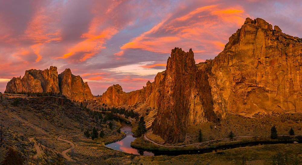 A dramatic sunrise fills the sky above Smith Rock State Park in Central Oregon.