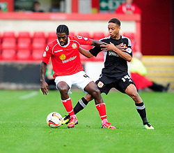Crewe Alexandra's Anthony Grant holds up the ball from Bristol City's Bobby Reid - Photo mandatory by-line: Dougie Allward/JMP - Tel: Mobile: 07966 386802 19/10/2013 - SPORT - FOOTBALL - Alexandra Stadium - Crewe - Crewe V Bristol City - Sky Bet League One