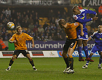 Photo: Steve Bond/Sportsbeat Images.<br /> Wolverhampton Wanderers v Leicester City. Coca Cola Championship. 22/12/2007.Collins John (R) gets a header in above Darren Ward(CR)