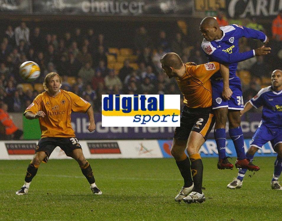 Photo: Steve Bond/Sportsbeat Images.<br /> Wolverhampton Wanderers v Leicester City. Coca Cola Championship. 22/12/2007.Collins John (R) gets a header in above Darren Ward(CR)