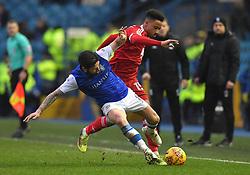 Birmingham City's Cohen Bramall battles with Sheffield Wednesday's Jacob Butterfield