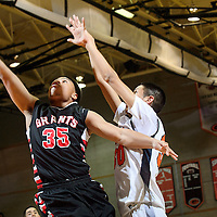 022714  Adron Gardner/Independent<br /> <br /> Grants Pirate Lionel Money (35), left, extends for a layup ahead of Gallup Bengal Mathew Begay (30) in the district 6-4A tournament at Gallup High School in Gallup Thursday