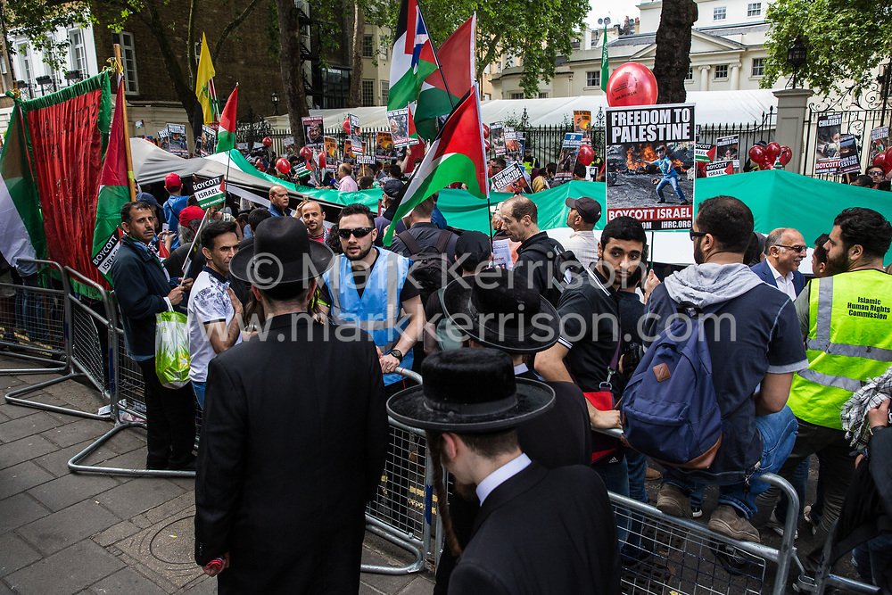 London, UK. 10th June, 2018. Orthodox Haredi Jews from Neturei Karta arrive outside the Saudi embassy to take part in the pro-Palestinian Al Quds Day march through central London organised by the Islamic Human Rights Commission. An international event, it began in Iran in 1979. Quds is the Arabic name for Jerusalem.