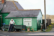 John Nisbet, a 79 years old man married without children is standing outside his Armstrong Cottage on Wednesday, March 17, 2021, in Bamburgh. The Armstrong Cottages who originally was built by Lord Armstrong for the workmen restoring Bamburgh Castle are designated to experience wonderful views towards Bamburgh Castle and over to the dunes. The dunes and miles of golden sand are directly opposite the cottages. John remembers his old days when he was a boy telling saying that he bought one of the cottages for £14/k and now they're worth £400/k+. (Photo/ Vudi Xhymshiti)