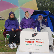 2021-09-11 Parliament square, London, UK. Three Afghan women sit in the rian went on the 6 days hunger strike to tell the British government to stop supporting terrorists proxy war in Afghanistan. Afghanistan want peace enough is enough.