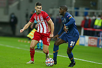 PIRAEUS, GREECE - DECEMBER 09: Nanu of FC Porto and Giorgos Masouras of Olympiacos FC during the UEFA Champions League Group C stage match between Olympiacos FC and FC Porto at Karaiskakis Stadium on December 9, 2020 in Piraeus, Greece. (Photo by MB Media)