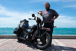Jim Gilfoyle at the waters edge with Midge, the 1938 Harley-Davidson El Knucklehead he rode in the Cross Country Chase motorcycle endurance run from Sault Sainte Marie, MI to Key West, FL. (for vintage bikes from 1930-1948). The Grand Finish in Key West's Mallory Square after the 110 mile Stage-10 ride from Miami to Key West, FL and after covering 2,368 miles of the Cross Country Chase. Sunday, September 15, 2019. Photography ©2019 Michael Lichter.