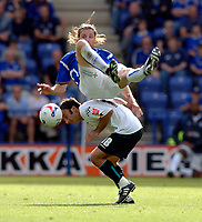 Photo: Henry Browne.<br /> Leicester City v Luton. Coca Cola Championship.<br /> 27/08/2005.<br /> Nils-Eric Johansson of City falls over the top of Ahmet Brkovic of Luton.
