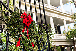 December 21, 2017 - Charleston, South Carolina, United States of America - The wrought iron gate of a historic home decorated with a Christmas wreath on Lagare Street in Charleston, SC. (Credit Image: © Richard Ellis via ZUMA Wire)