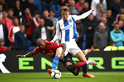 Manchester United's Ashley Young (left) and Brighton & Hove Albion's Solly March battle for the ball