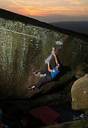 Adam Lincoln climbing the classic boulder problem Brad Pit, font 7c+, Stanage Plantation, Peak District UK