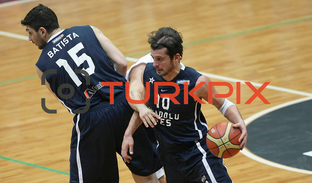Anadolu Efes's Kerem Tunceri (R) during their Turkish Basketball league derby match Besiktas between Anadolu Efes at the BJK Akatlar Arena in Istanbul Turkey on Saturday 31 December 2011. Photo by TURKPIX