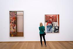 Woman looking at paintings by Robert Rauschenberg at Hamburger Bahnhof modern art museum in Berlin, Germany