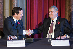 © Licensed to London News Pictures . 03/11/2014 . Manchester , UK . The Chancellor of the Exchequer George Osborne MP and Lord Peter Smith at Manchester Town Hall signing a deal to devolve power to Greater Manchester , including giving the city a Mayor and greater control over its finances . Photo credit : Joel Goodman/LNP