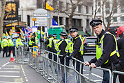 Police observe hundreds of British Kashmiri protestors who assembled outside the Indian High Commission on Sunday, 26 January 2020 to protest against Indian occupation of Kashmir and the lockdown of the occupied territory following the revocation of Article 370.<br /> The north-eastern region, on the border with Pakistan, is the only Muslim majority state in Hindu-dominated India. But in August 2019, the Indian government revoked Kashmir's special status – this had previously allowed it to have its own constitution and internal government.