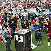 South Carolina Gamecocks defensive end Jadeveon Clowney (7) exits the playing field after the NCAA Capital One Bowl football game between the South Carolina Gamecocks who represent the SEC and the Wisconsin Badgers who represent the Big 10 Conference, at the Florida Citrus Bowl on Wednesday, January 1, 2014 in Orlando, Florida.   South Carolina won the game 34-24. (AP Photo/Alex Menendez)