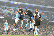 35 Oleksandr Zinchenko for Manchester City and Rotherham United defender Clark Robertson (15) jump for the ball during the The FA Cup 3rd round match between Manchester City and Rotherham United at the Etihad Stadium, Manchester, England on 6 January 2019.