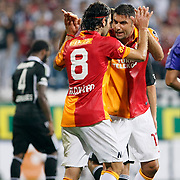 Galatasaray's Selcuk inan (L) with Burak Yilmaz celebrating his goal during their Turkish Superleague soccer derby match Besiktas between Galatasaray at the Inonu Stadium at Dolmabahce in Istanbul Turkey on Thursday, 26 August 2012. Photo by TURKPIX