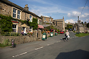 The village shop in Muker in Swaledale, which runs broadly from west to east. To the south and east of the ridge a number of smaller dales. Swaledale is a typical limestone Yorkshire dale, with its narrow valley-bottom road. Yorkshire, England, UK.