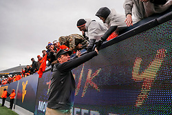 Nov 23, 2019; Morgantown, WV, USA; Oklahoma State Cowboys head coach Mike Gundy celebrates with fans after his team defeated the West Virginia Mountaineers at Mountaineer Field at Milan Puskar Stadium. Mandatory Credit: Ben Queen-USA TODAY Sports